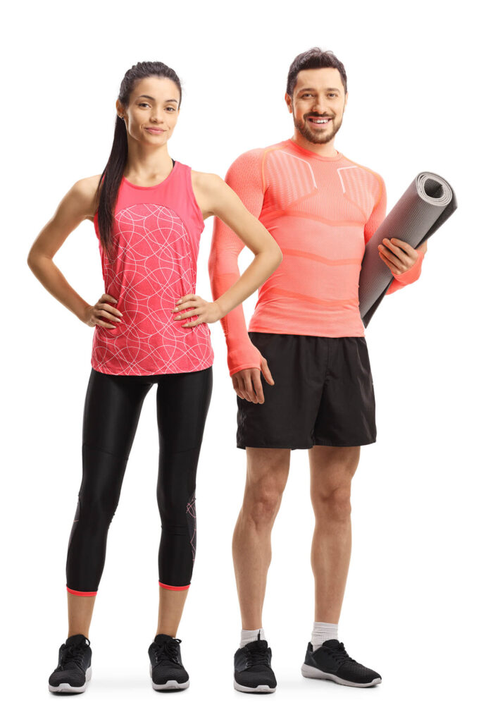 Fitness photo full length portrait of a sporty female and a young man holding an exercise mat and smiling 1755807416