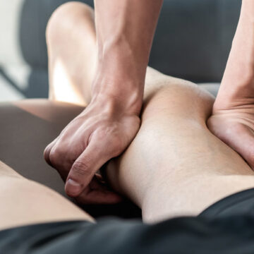 Fisioterapia photo male therapist giving leg and calf massage to athlete patient on the bed in clinic sports physical 1209919798