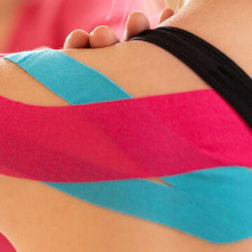Kinesi2 photo kinesiology physical therapy rehabilitation banner female patient wearing kinesio tape on her 1627478020